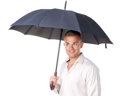 Happy young man under an umbrella isolated on white background photo