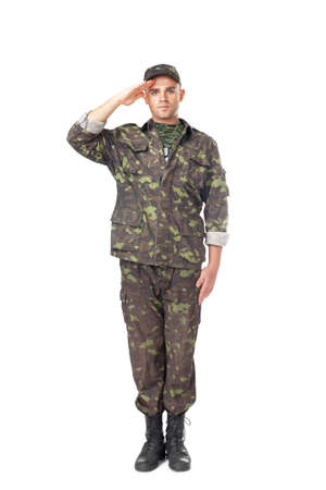 military boots: Full length portrait of young army soldier saluting isolated on white background