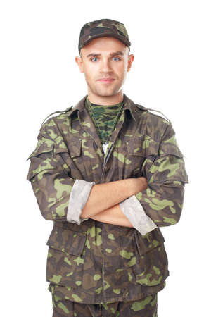 only 1 man: Smiling army soldier with his arms crossed isolated on white background Stock Photo