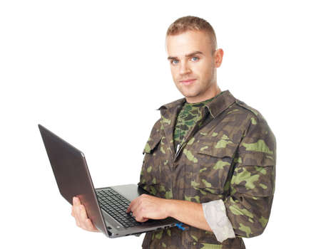 Portrait of young army soldier with a laptop isolated on white background