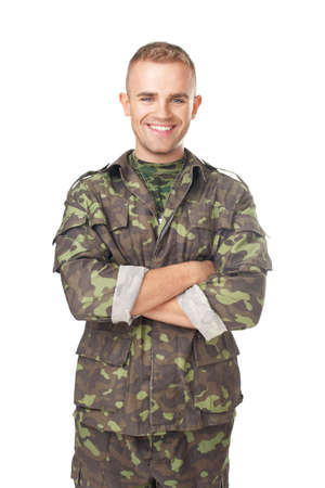 males only: Smiling army soldier with his arms crossed isolated on white background Stock Photo