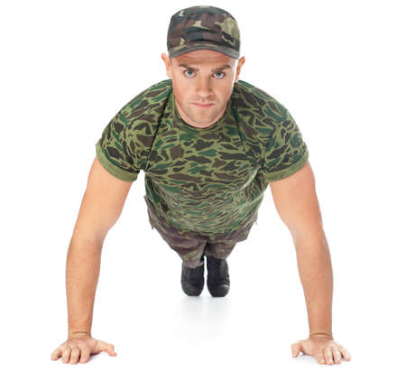 military training: Young army soldier doing push up isolated on white background Front view Stock Photo