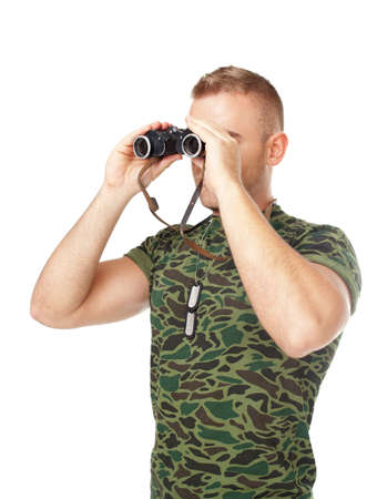 Young army soldier looking through binoculars isolated on white background photo