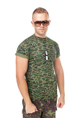 Young army soldier wearing sunglasses isolated on white background photo