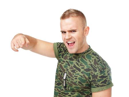 infuriate: Loud scream of anger furious army soldier pointing towards camera isolated on white background