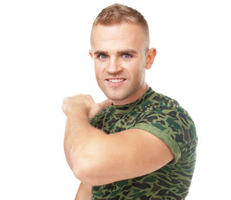 threatened: Young army soldier threatened to cut the throat isolated on white background