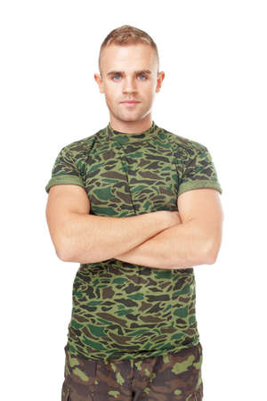 military man: Serious army soldier with his arms crossed isolated on white background Stock Photo