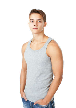 Portrait of young man wearing t-shirt standing with hands in pockets isolated on white background photo