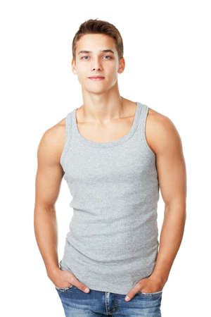 male model: Portrait of young man wearing t-shirt standing with hands in pockets isolated on white background