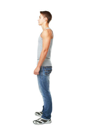 Full length side view portrait of young man isolated on white background photo