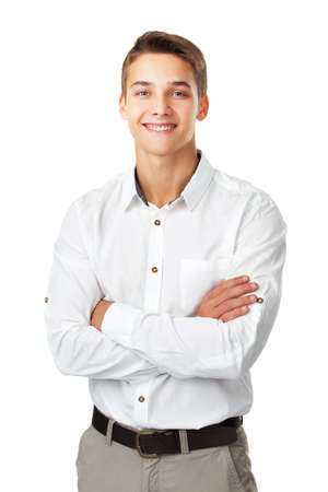 folded hands: Portrait of happy smiling young man wearing a white shirt standing with hands folded against isolated on white background Stock Photo