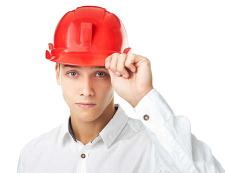 Portrait of young engineer wearing red helmet isolated on white background Stock Photo