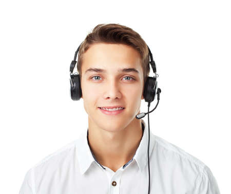 Closeup portrait of young man call center employee with a headset isolated on white background Stok Fotoğraf