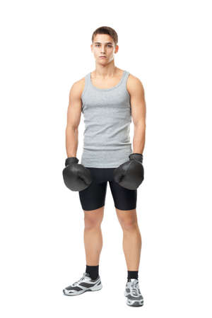 Full length portrait of young muscular athlete man with boxing gloves isolated on white  photo