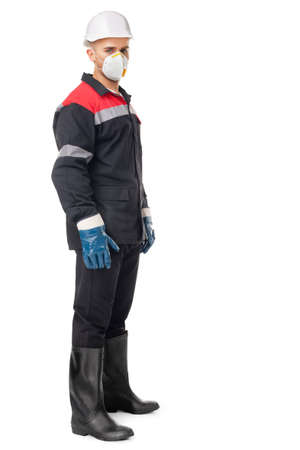 protective workwear: Full length portrait of young worker wearing safety protective gear isolated on white background Stock Photo