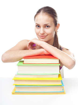 only 1 girl: Portrait of pretty young happy smiling student girl with pile of books isolated on white background Stock Photo