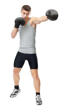 Full length portrait of young boxer making punch isolated on white background
