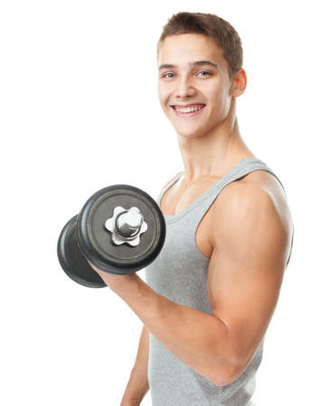 arms body: Portrait of smiling young fit muscular man exercising with dumbbells for training his biceps isolated on white background