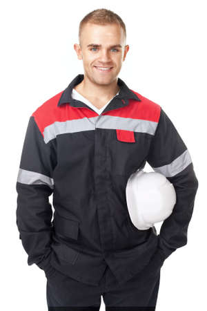 Portrait of young smiling engineer holding white helmet isolated on white background
