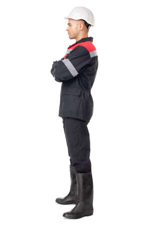 Full length side view portrait of young worker isolated on white background