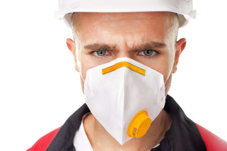 Closeup portrait of serious worker wearing respirator and white helmet isolated on white background photo