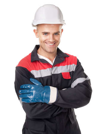 Portrait of young smiling worker with protective helmet and gloves isolated on white background photo
