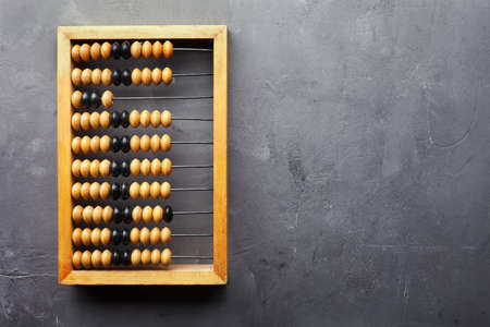 Accounting abacus on gray textured background with copy space