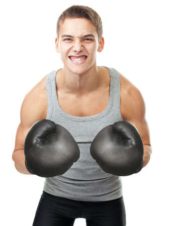 Portrait of angry young boxer with a grin isolated on white background