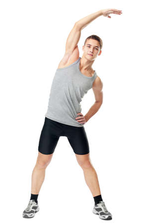 Full length portrait of young man athlete doing exercises isolated on white background photo