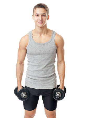 Portrait of young smiling bodybuilder with heavy dumbbells isolated on white background
