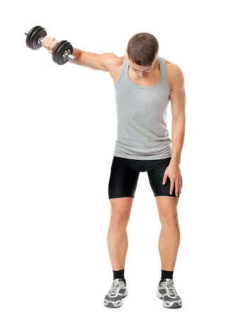 Full length portrait of young fit muscular man exercising with dumbbells for training his deltoids muscle isolated on white background Stock Photo
