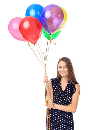 Portrait of beautiful young happy woman in polka dot dress with colorful balloons isolated on white background photo