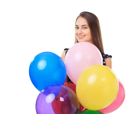 Portrait of beautiful young happy woman with colorful balloons isolated on white background photo