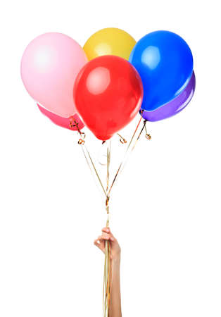 Hand holding colorful balloons isolated on white background photo