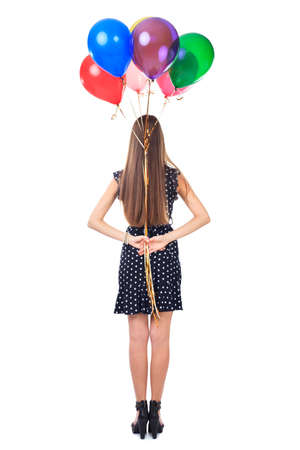 gift behind back: Full length back view of woman in polka dot dress holding colorful balloons behind her back isolated on white background