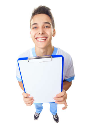 top angle view: Wide angle top view of  happy laughing young doctor showing empty clipboard isolated on white background