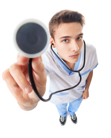 serious doctor: Wide angle top view of young doctor with stethoscope isolated on white background