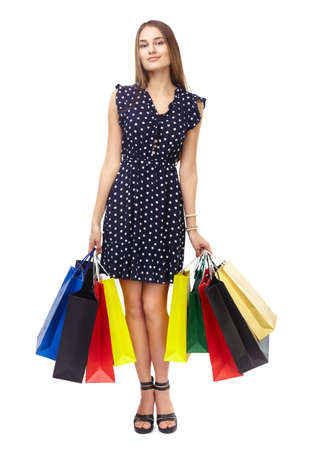 Full length portrait of young beautiful smiling woman holding many colorful shopping bags isolated on white background Stock Photo - 26733622