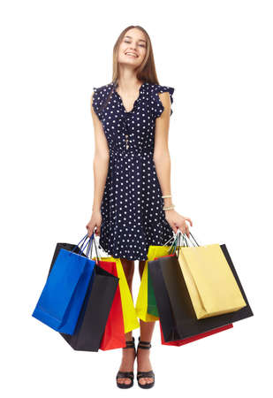 Full length portrait of young beautiful smiling woman holding many colorful shopping bags isolated on white background Stock Photo - 26733624