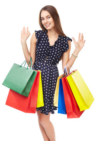 Portrait of young beautiful smiling happy woman with many colorful shopping bags showing hello sign isolated on white background photo