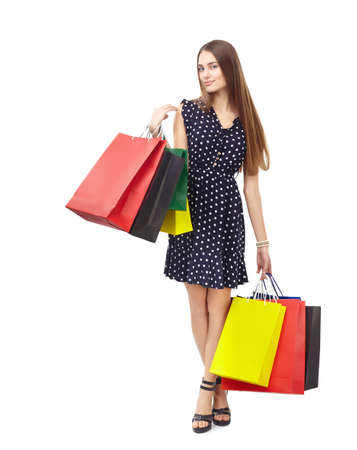Full length portrait of young beautiful smiling happy woman holding many colorful shopping bags isolated on white background Stock Photo - 27292675