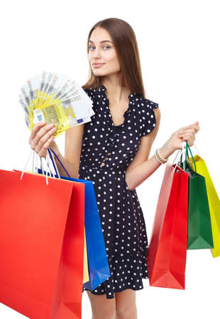 spender: Portrait of young beautiful smiling happy woman with euro banknotes money and many colorful shopping bags isolated on white background Stock Photo