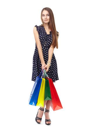 Full length portrait of young beautiful smiling happy woman holding many colorful shopping bags isolated on white background Stock Photo - 27292717