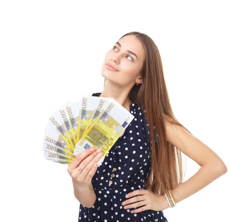Portrait of young beautiful woman holding euro banknotes money dreaming and looking up isolated on white background Stock Photo - 27292720