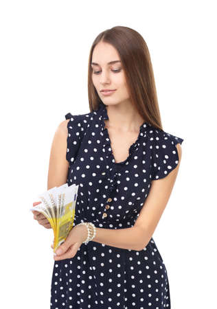 Portrait of young beautiful woman holding bundle of euro money isolated on white background photo