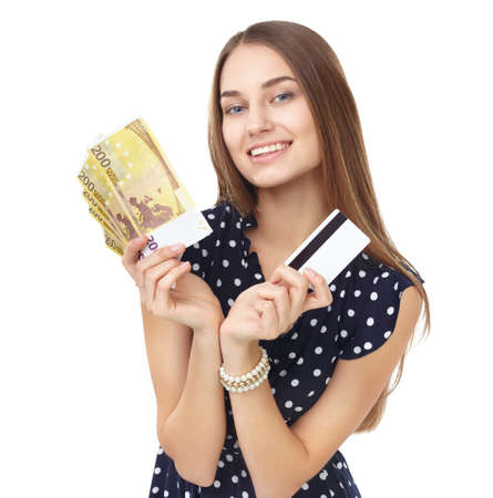 Portrait of young beautiful smiling woman holding euro banknotes money and credit card isolated on white background photo