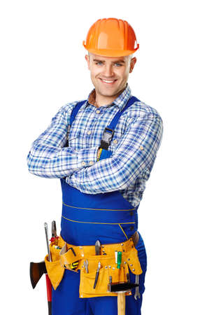 Portrait of happy young male construction worker with tool belt isolated on white background photo
