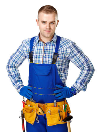 Portrait of young male construction worker with tool belt isolated on white background photo