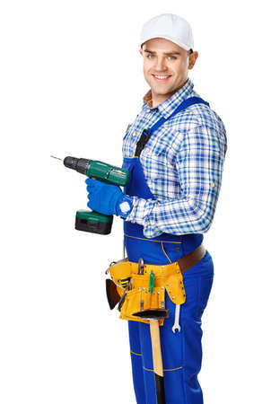 Portrait of happy young male construction worker with electric drill isolated on white background photo