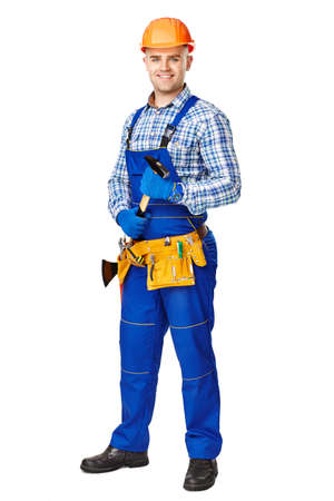 Full length portrait of smiling young male construction worker with hammer,wearing protective clothes,gloves and helmet isolated on white background photo